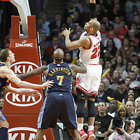 26 March 2012: Chicago Bulls forward Taj Gibson (22) goes for the skyhook over Denver Nuggets power forward Al Harrington (7) during the Denver Nuggets 108-91 victory over the Chicago Bulls at the United Center, Chicago, Illinois, USA. NOTE TO USER: User expressly acknowledges and agrees that, by downloading and or using this photograph, User is consenting to the terms and conditions of the Getty Images License Agreement. Mandatory Credit: 2012 NBAE (Photo by Chris Elise/NBAE via Getty Images)