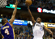 Mike James (13) of the Dallas Mavericks shoots a layup over Antwan Jamison (4) of the Los Angeles Lakers at the American Airlines Center in Dallas on Sunday, February 24, 2013. (Cooper Neill/The Dallas Morning News)