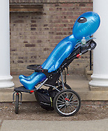 Pine Bush, New York - An inflatable alien stands in a stroller at the Pine Bush UFO Fair on  on April 26, 2014.