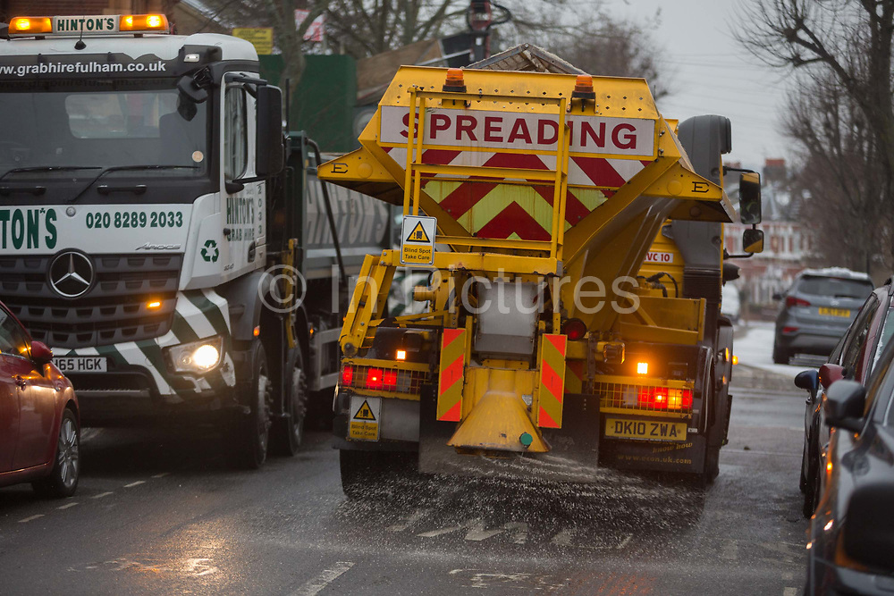 A Lambeth council gritting lorry spreads grit over a minor residential road in south London during the bad weather covering every part of the UK and known as the Beast from the East because Siberian winds and very low temperatures have blown across western Europe from Russia, on 1st March 2018, in Lambeth, London, England.