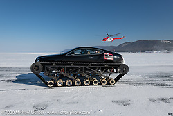 Academeg (Konstantin Zarucki), a YouTuber with 4.3 million subscribers racing his Bentley Continental Ultratank, a Continental (new Continentals start at $202,000!) that he modified with winter tracks. He's on the 1-mile track racing a helicopter in the Baikal Mile Ice Speed Festival. Maksimiha, Siberia, Russia. Friday, February 28, 2020. Photography ©2020 Michael Lichter.