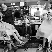 Brothers get their hair cut at Durdens Barber Shop in Augusta, Georgia. The barber shop has been a fixture in the community for over 50 years.