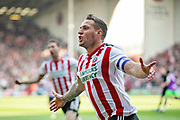 Sheffield Utd forward Billy Sharp (10) celebrates his goal 1-0 during the EFL Sky Bet Championship match between Sheffield United and Bristol City at Bramall Lane, Sheffield, England on 30 March 2019.