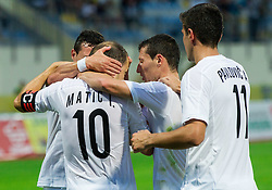 Igor Matic, Slavoljub Srnic and other players of Cukaricki celebrate after scoring first goal for Cukaricki during 1st Leg football match between NK Domzale (SLO) na FC Cukaricki (SRB) in 1st Round of Europe League 2015/2016 Qualifications, on July 2, 2015 in Sports park Domzale,  Slovenia. Photo by Vid Ponikvar / Sportida