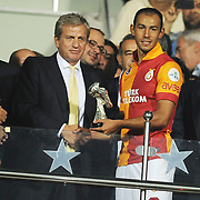 Galatasaray's players celebrate with the trophy after their Turkish Super Cup 2012 soccer derby match Galatasaray between Fenerbahce at the Kazim Karabekir stadium in Erzurum Turkey on Sunday, 12 August 2012. Photo by TURKPIX