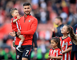 Southampton's Shane Long walks the lap of appreciation with his children during the Premier League match at St Mary's Stadium, Southampton.