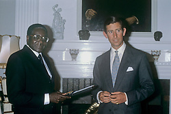 File photo dated 19/04/80 of the Prince of Wales (right) receiving an Independence Medal from Robert Mugabe, whose legacy as one of the most ruthless tyrants of modern times will remain long after his days as notorious statesman of Zimbabwe are over.