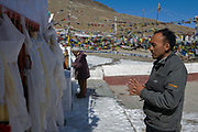 Indo Tibetan men pray at the Buddhist Stupa on the Kunzum pass in the high Himalaya near Kaza, Spiti, on 25th October 2009, Himachal Pradesh, India. The region of Spiti is a remote and tribal area of the Indian Himalayas near the Tibetan border.