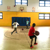 A boy plays basketball at the Hunting Park Recreation Center on June 28, 2016 in Philadelphia, Pennsylvania.