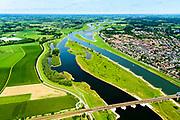 Nederland, Gelderland / Overijssel, Deventer, 17-07-2017; IJssel met uiterwaarden met spoorbrug, ter hoogte van de Ossenwaard. Om het IJsselwater bij hoogwater sneller af te voeren zijn bij Deventer zijn in het kader van het programma Ruimte voor de Rivier de uitwaarden vergraven om een hoogwatergeul te creëren. Foto stroomafwaarts.<br /> NOOT: Zie ook opnames van de oorspronkelijke situatie.<br /> IJssel with floodplains. In order to facilitate the flood of water from river IJssel at high waters, floodplains have been has excavated and and a flood chanel has been created.<br /> See also recordings of the original situation.<br /> luchtfoto (toeslag op standard tarieven);<br /> aerial photo (additional fee required);<br /> copyright foto/photo Siebe Swart