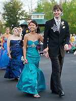 """James Guyer and his date Lily Chantitaske march at Meadowbrook for the Laconia High Schools """"Grammy"""" themed prom Friday evening.  (Karen Bobotas/for the Laconia Daily Sun)"""