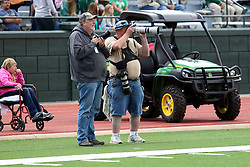 19 September 2015:   Photographers Steve Smedley and Tom dither during an NCAA division 3 football game between the Simpson College Storm and the Illinois Wesleyan Titans in Tucci Stadium on Wilder Field, Bloomington IL