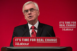 London, UK. 13 November, 2019. John McDonnell, Shadow Chancellor, addresses a press conference where he, together with Shadow Health Secretary Jonathan Ashworth, unveiled a Labour Party 'rescue plan' for the National Health Service (NHS) including a pledge of a £26bn p.a. real-terms increase in budget by 2023/24, to be funded by increased taxation on companies and the wealthiest in society. This pledge would give the NHS £5.5bn more per year than promised by the Conservative Party.