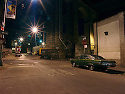 Old Dodge Swinger car parked under the Manhattan Bridge Brooklyn NY 2004.