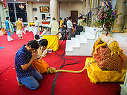 17 AUGUST 2014 - BANGKOK, THAILAND:   People pray at the crib that represents the crib of Krishna during Krishna Janmashtami observances at the Vishnu temple in Bangkok. Krishna Janmashtami is the annual celebration of the birth of the Hindu deity Krishna, the eighth avatar of the Hindu god Vishnu. It is celebrated by Hindus in Thailand. There are about 53,000 Hindus in Thailand, most originally from India, but many Hindu deities are highly revered by Thai Buddhists and Hindu holy days are observed by many Thai Buddhists.    PHOTO BY JACK KURTZ