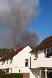 © licensed to London News Pictures. LONDON, UK  03/05/2011. A forest fire continues to burn out of control in Swinley Forest, Bracknell, Berkshire. It started days ago and is now threatening Broodmoor Hospital as well as nearby houses. Hospital staff at the scene were preparing for an evacuation of inmates as the fire front was less than 100 meters from the perimeter fence. Please see special instructions for usage rates. Photo credit should read CLIFF HIDE/LNP