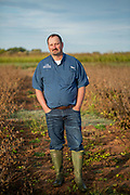 Jason Norsworthy stands in a soy bean field at the Arkansas Agricultural Research & Extension Center farm on Monday, Oct. 24, 2018, in Fayetteville, Ark. Norsworthy is doing research on dicamba drift.<br /> <br /> Photo by Beth Hall