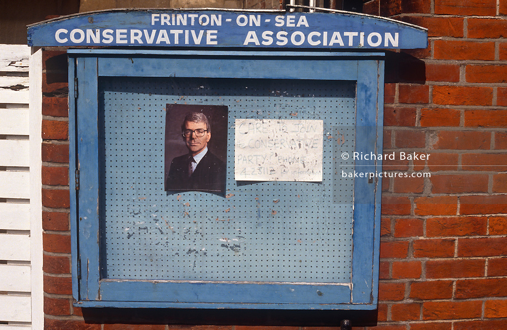 British Prime Minister, John Major's portrait is behind glass on a Conservative Association's noticeboard on 1st April 1992, in the seaside town of Frinton, Essex, England. Major went on to win the election in April that year and was the fourth consecutive victory for the Conservative Party although it was its last outright win until 2015 after Labour's 1997 win for Tony Blair.