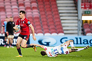 Mark Atkinson of Gloucester Rugby evades the tackle of Dan John of Exeter Chiefs during the Gallagher Premiership Rugby match between Gloucester Rugby and Exeter Chiefs at the Kingsholm Stadium, Gloucester, United Kingdom on 26 March 2021.