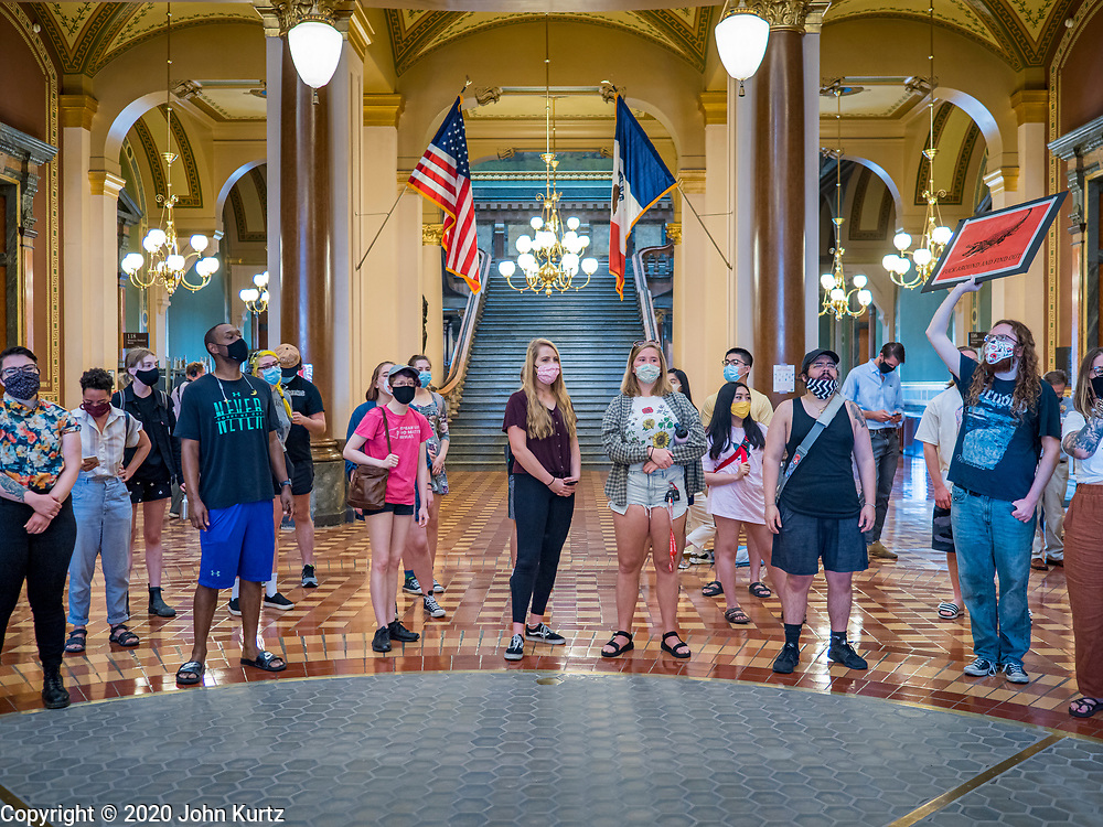 15 JUNE 2020 - DES MOINES, IOWA: Supporters of Black Lives Matter protest against Iowa Governor Kim Reynolds in the rotunda of the Iowa capitol in Des Moines. About 75 supporters of Black Lives Matter marched through the Iowa capitol Monday to demand the restoration of voting rights for felons who have completed their sentences. Iowa is one of only two states in the US that permanently strip felons of voting rights. The issue is a  racial one in Iowa. Blacks make up only 4 percent of the population but 25 percent of the prison population. The Governor agreed to meet with a delegation of the protesters but she would not commit to immediately restoring voting rights. She said would draft an executive order to restore voting rights later in the summer.    PHOTO BY JACK KURTZ