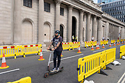 As Britain enters a period of deep recession, the streets are very quiet outside the Bank of England in the City of London with social distancing temporary road layouts marked out with rows of yellow barriers on 12th August 2020 in London, United Kingdom. The Office for National Statistics / ONS has announced that gross domestic product / GDP, the widest gauge of economic health, fell by 20.4% in the second quarter of the year, compared with the previous quarter. This is the biggest decline since records began. The result is that Britain has officially entered recession, as the UK economy shrank more than any other major economy during the coronavirus outbreak.