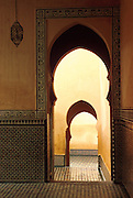 MOROCCO, MEKNES the Tomb of Moulay Ismail, 1672-1727; arched doorways and mosaics in the interior