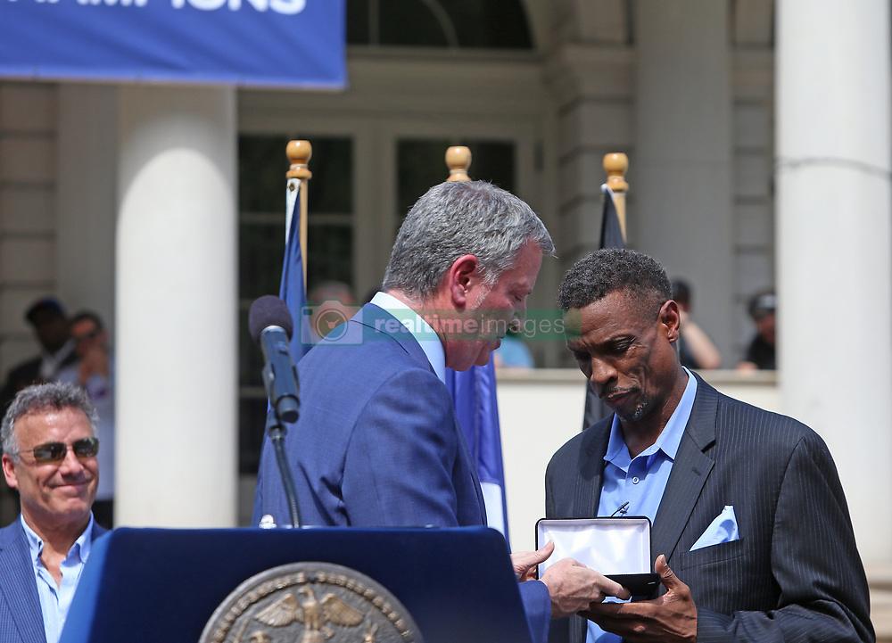 April 28, 2017 - New York City, NY, United States - Mayor Bill de Blasio presents award to Dwight ''Doc'' Gooden on the steps of NYC City Hall. NYC Mayor Bill de Blasio joined former Mets players Jesse Orosco, Bobby Ojeda & Darryl Strawberry on the steps of New York City hall to honor Cy Young Award winner & key player in the Mets's 1986 World Series championship, Dwight ''Doc'' Gooden...Gooden, who has long struggled with alcohol & cocaine addiction, had been incapacitated & unable to participate in the team's victory parade along Broadway thirty-one years prior. (Credit Image: © Andy Katz/Pacific Press via ZUMA Wire)