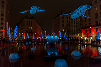 Pikooks   - Place de la République, Lyon 2<br /> Artist: Christophe Martine<br /> TheFestival of Lights inLyon,Franceexpresses gratitude towardMary, mother of Jesusaround December 8th of each year.<br /> This uniquely Lyonnaise tradition dictates that every house place candles along the outsides of all the windows to produce a spectacular effect throughout the streets. The festival includes other activities based on light and usually lasts four days, with the peak of activity occurring on the 8th. <br /> The two main focal points of activity are typically theBasilica of Fourvierewhich is lit up in different colours, and thePlace des Terreaux, which hosts a different light show each year.<br /> Spared from plague<br /> The origins of the festival date to 1643 when Lyon was struck byplague. <br /> On September 8,1643 the municipal councillors promised to pay tribute to Mary if the town was spared. Ever since, a solemn procession makes its way to the Basilica of Fourviere on 8 December (the feast of theImmaculate Conception) to light candles and give offerings in the name of Mary. <br /> In part, the event thus commemorates the day Lyon was consecrated to the Virgin Mary.