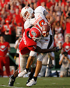 ATHENS - SEPTEMBER 1: Mohamed Massaquoi #1 of the Georgia Bulldogs tackles punter Matt Fodge #18 of the Oklahoma State Cowboys after an errant snap went past Fodge during the game on September 1, 2007 at Sanford Stadium in Athens, Georgia.  (Photo by Mike Zarrilli/Getty Images)