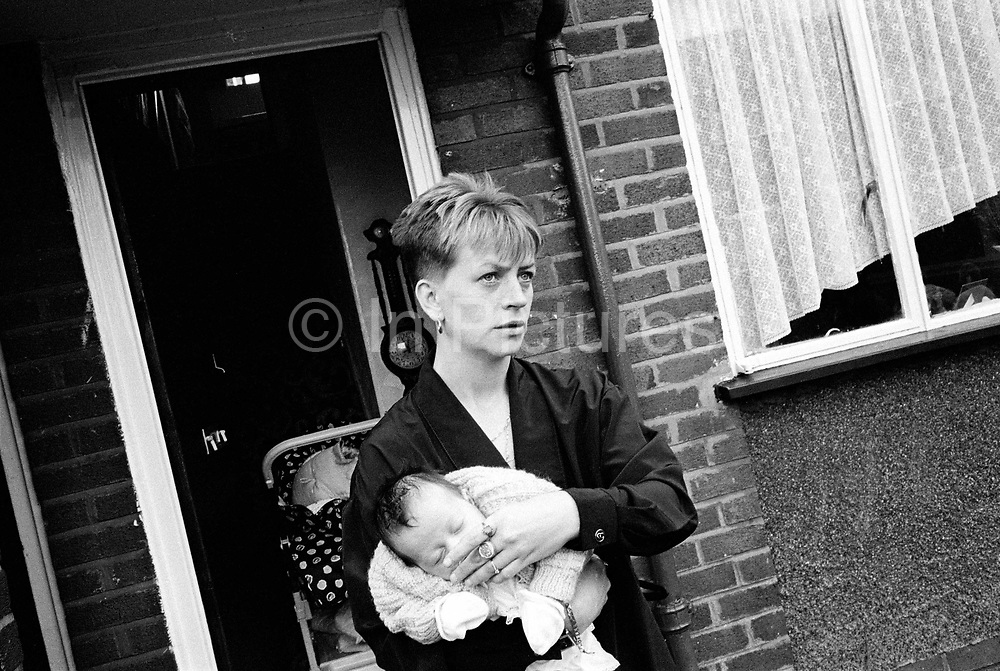 A woman and her new baby on the Northwood Estate in Kirkby, Merseyside, a notoriously run down inner city area