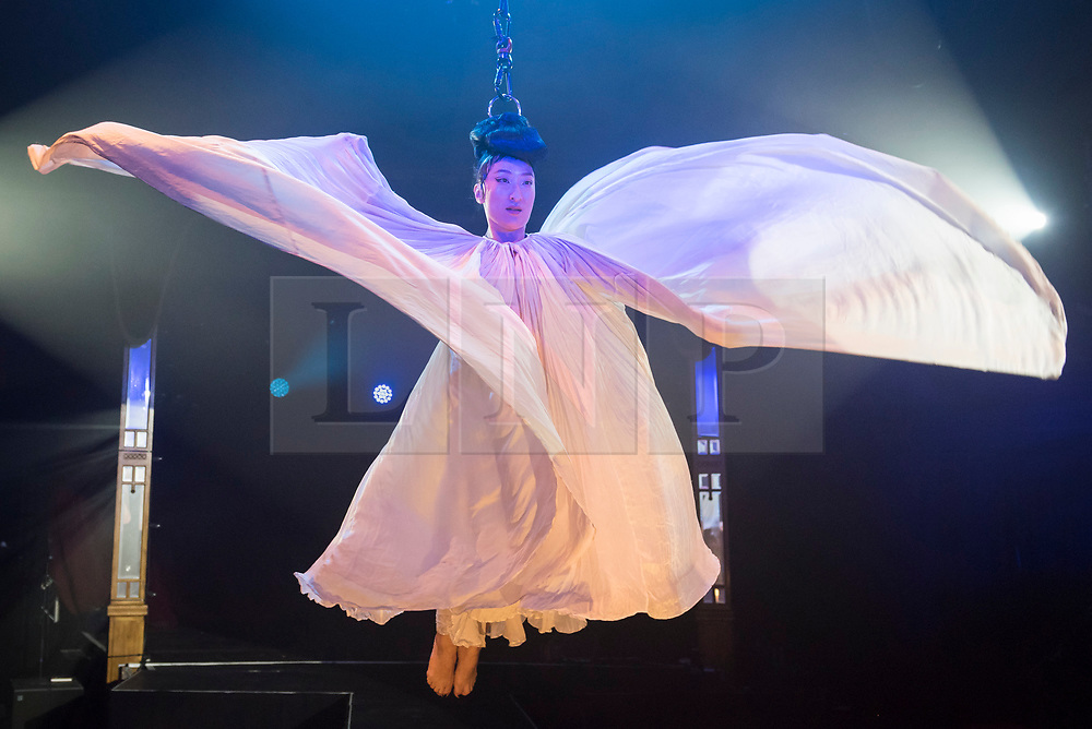 """© Licensed to London News Pictures. 24/04/2019. LONDON, UK. Fancy Chance, hair hanging dynamo, performs at the preview of Bernie Dieter's """"Little Death Club"""" an eclectic performance show taking place at the Underbelly Festival on the Southbank until 23 June 2019.  Photo credit: Stephen Chung/LNP"""
