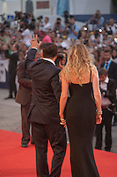 Johnny Depp and Amber Heard  waving at fans at the gala screening for the film Black Mass at the 72nd Venice Film Festival, Friday September 4th 2015, Venice Lido, Italy.