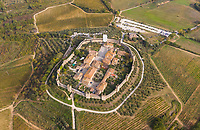Aerial view above of historic city of Monteriggioni during sunset, Italy.