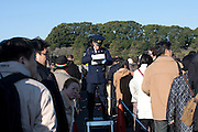 Police control well-wishers as they enter the Imperial Palace. Emperor Akihito 76th birthday was celebrated in Japan with a national holiday and thousands of well-wishers being allowed into the Royal Palace for the occasion. He made three appearances during the day and spoke of the economy difficulties many Japanese people are suffering during his address. He was accompanied by Empress Michiko, Crown Prince Naruhito, Prince Akishino and their wives. Tokyo, Japan December 23rd 2009