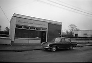 Hibernian Bank sub-office at Dunshaughlin..1965..13.03.1965..03.13.1965..13th March 1965..The Hibernian Bank sub-office at Dunshaughlin, Co. Meath was broken into lat night, it has not yet been determined how much money the raiders managed to escape with...Image shows a Garda sergeant with members of the Garda Technical Branch who had arrived to inspect the bank's premises.