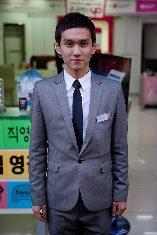 Daegu/South Korea, Republic Korea, KOR, 03.11.2011: Portrait of a store clerk in the South Korean city of Daegu.