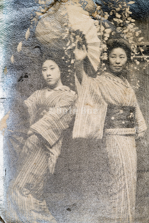 deteriorating portrait of two woman in a tradtional dance pose  Japan ca 1930s
