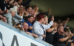 EDITOR NOTE GESTURE Derby fan gestures to Millwall fans after their first goal