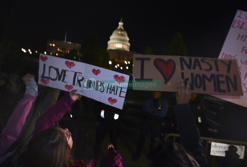 November 11, 2016 - Washington, DC, USA - Protests erupt over 2016 Presidential election results in Washington DC with Donald Trump winning over Hillary Clinton. Clinton supporters take to the streets, stopping at Trump hotel, the White House and Capitol. 'This is the revolution,' they declared. (Credit Image: © Carol Guzy via ZUMA Wire)