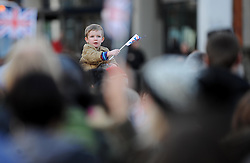 A young boy waves his union jack flag amongst the crowd  - Photo mandatory by-line: Dougie Allward/JMP - Tel: Mobile: 07966 386802 03/03/2014 -