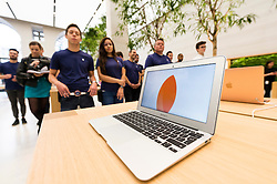 © Licensed to London News Pictures. 13/10/2016. Macbook Air laptop on display at the new Apple store in Regent Street is unveiled at a press preview with a new exterior and interior design concept by Foster + Partners.  Regent St was the first Apple store in Europe and has served over 60 million customers over the past 12 years. London, UK. Photo credit: Ray Tang/LNP