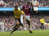 Photo: Olly Greenwood.<br />West Ham United v Arsenal. The Barclays Premiership. 05/11/2006. West Ham's Nigel Reo-Coker gets past Arsenal's Mathieu Flamini