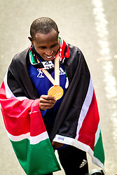 ING New York CIty Marathon: Geoffrey Mutai with winner's medal and draped in flag of Kenya after victory
