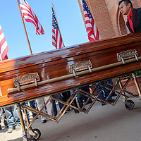 072415  Adron Gardner/Independent<br /> <br /> A casket containing the remains of Navajo Code Talker and Marine Corps veteran Kee Etsicitty is pushed out from Sacred Heart Cathedral after a Catholic Mass in Gallup Friday.  Etsicitty died, July 21 at the age of 93.<br /> <br /> <br /> *** KEE WAS 93 YEARS OLD, NOT 92 AS WE PUBLISHED. I PHOTOGRAPHED HIM ON HIS BIRTHDAY AT RUN FOR THE WALL EARLIER THIS YEAR*****