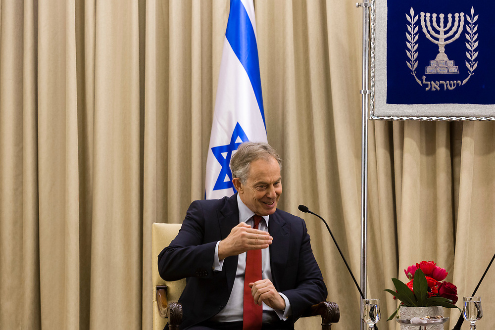Former British Prime Minister and Quartet Special Envoy to the Middle East Tony Blair gestures as he speaks during his meeting with Israel's President Shimon Peres (not pictured) at the Israeli President's residence in Jerusalem, on January 30, 2014.