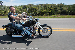 """""""Moonshiner Josh"""" Owens with his dog """"Cutie Pie"""" riding his 2005 Harley-Davidson Softail on A1A along the ocean south of Flagler Beach during Daytona Beach Bike Week 2015. FL, USA. March 13, 2015.  Photography ©2015 Michael Lichter."""