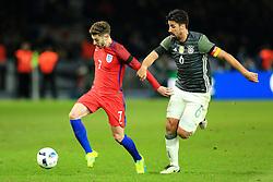 Englands Adam Lallana is chased by Germanys Sami Khedira - Mandatory by-line: Matt McNulty/JMP - 26/03/2016 - FOOTBALL - Olympiastadion - Berlin, Germany - Germany v England - International Friendly