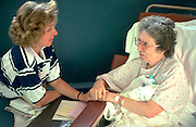 Daughter age 47 comforting mom 78 after breast surgery.  Robbinsdale  Minnesota USA