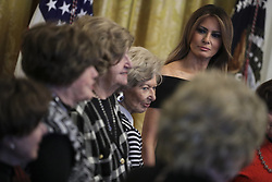 First Lady Melania Trump listens as she stands next to holocaust survivors during a Hanukkah reception with President Donald Trump in the East Room of the White House on December 6, 2018 in Washington, DC. (Photo by Oliver Contreras/SIPA USA)