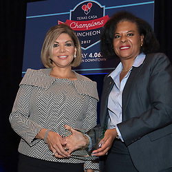 Texas Supreme Court Justice Eva Guzman, left,  receives an award from the Texas CASA (Court Appointed Special Advocates) for her support of the organization on April 6, 2017. Guzman, the first Hispanic woman to serve on the Texas Supreme Court, resigned her position and is rumored to be considering a challenge to Attorney General Ken Paxton.